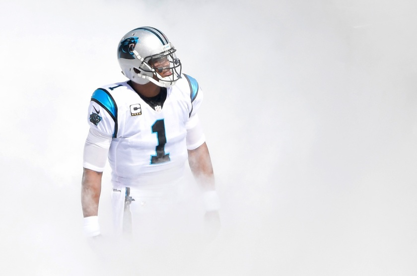 Cam Newton #1 of the Carolina Panthers emerges from the smoke before their game against the San Francisco 49ers at Bank of America Stadium on September 18, 2016 in Charlotte, North Carolina. (Grant Halverson/Getty Images)