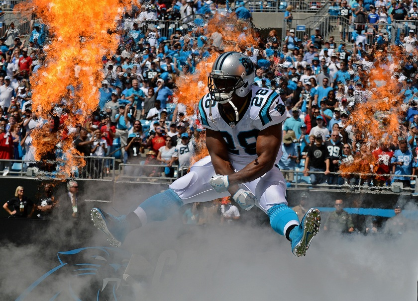 Carolina Panthers running back Jonathan Stewart leaps into the air as he is introduced prior to first quarter action against the San Francisco 49ers on Sunday, Sept. 18, 2016 at Bank of America Stadium in Charlotte, N.C. (Jeff Siner/Charlotte Observer/TNS via Getty Images)