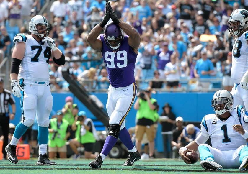 Danielle Hunter #99 of the Minnesota Vikings reacts after sacking Cam Newton #1 of the Carolina Panthers for a safety during the game at Bank of America Stadium on September 25, 2016 in Charlotte, North Carolina. (Grant Halverson/Getty Images)