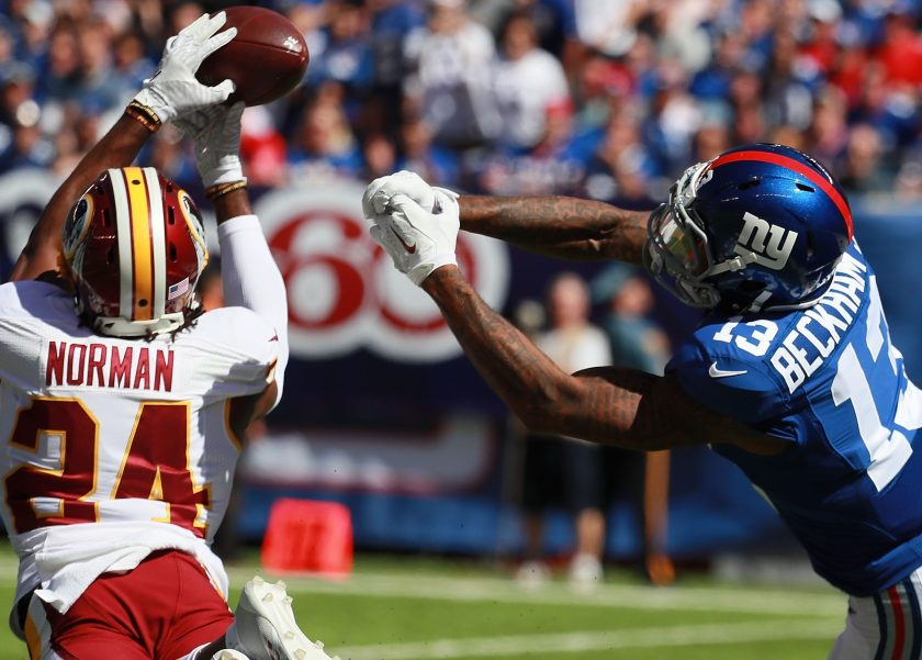 Josh Norman #24 of the Washington Redskins breaks up a pass to Odell Beckham #13 of the New York Giants at MetLife Stadium on September 25, 2016 in East Rutherford, New Jersey. (Michael Reaves/Getty Images)
