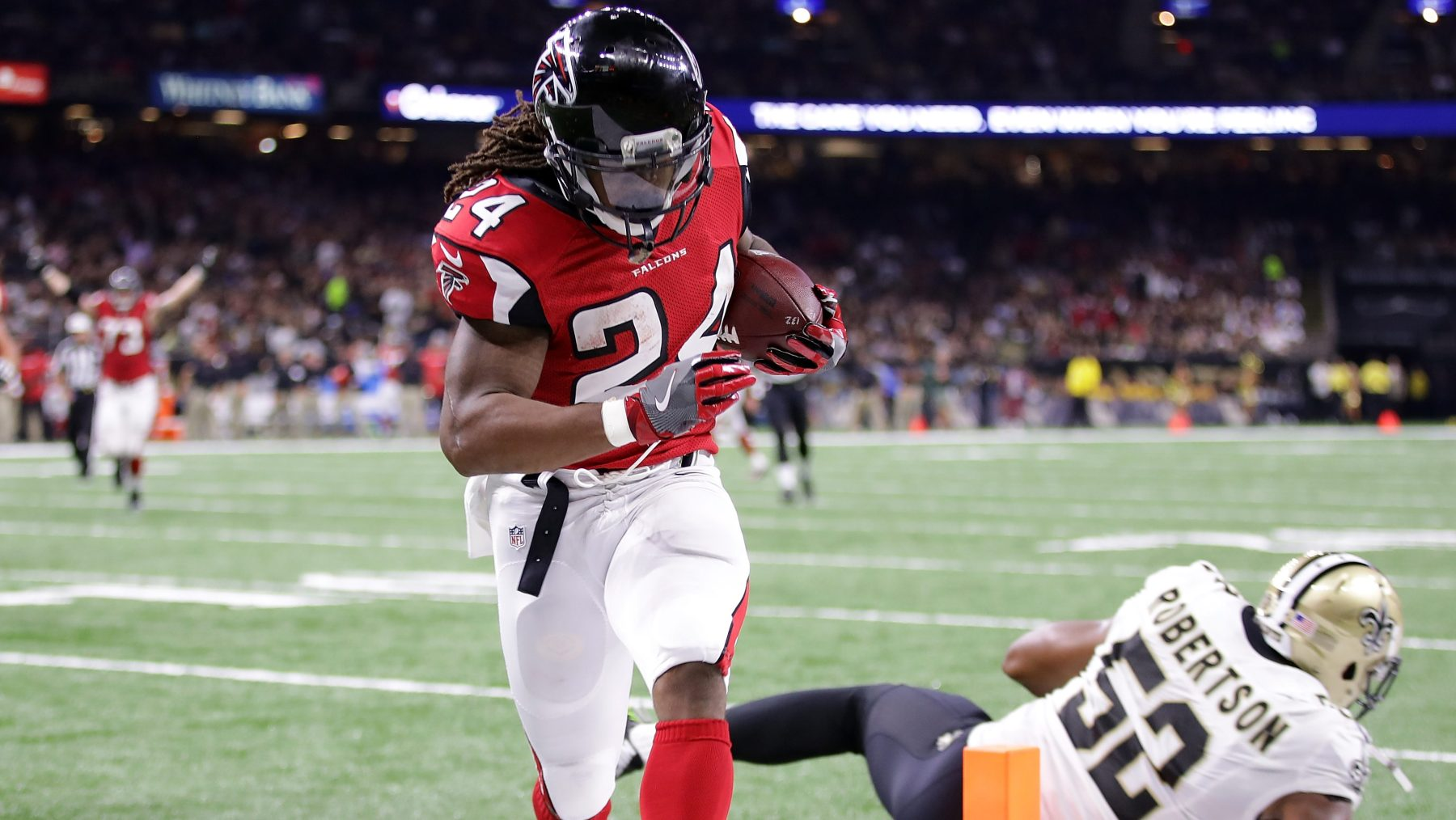 Devonta Freeman #24 of the Atlanta Falcons reacts after scoring a touchdown against the New Orleans Saints at the Mercedes-Benz Superdome on September 26, 2016 in New Orleans, Louisiana.  (Chris Graythen/Getty Images)