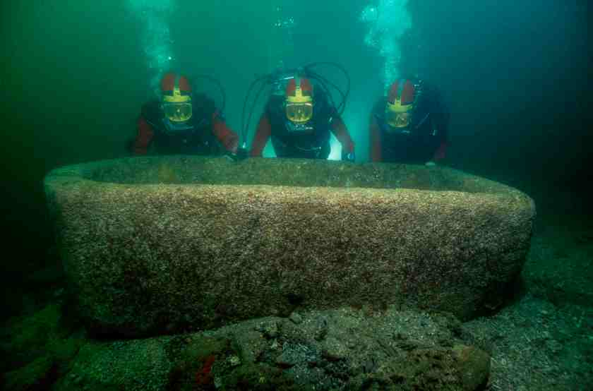 In the waters of Aboukir Bay, on the site of the now submerged ancient town of Canopus, a diver brings to light a ͚ Garden vat made of Pink granite. (Franck Goddio / Hilti Foundation)