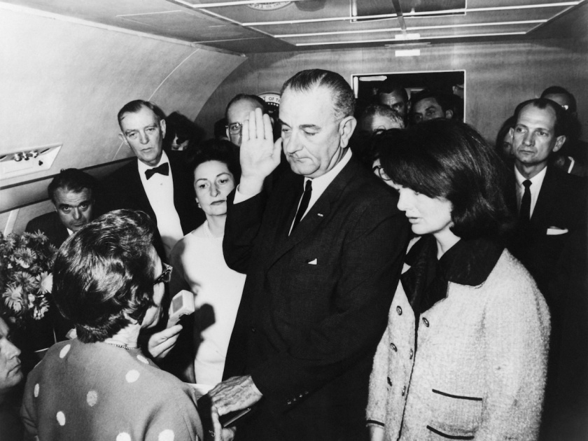 Lyndon Johnson (C) taking oath of office after President Kennedy's assassination aboard Air Force One, Former First Lady Jackie Kennedy (R), imminent First Lady Lady Bird (L), Jack Valenti, Congressmen Albert Thomas on november 22, 1963 in United States. (Keystone-France/Gamma-Keystone via Getty Images)