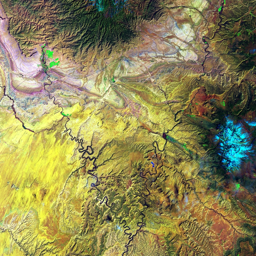 The Green River and the Colorado River meet within Canyonlands National Park in Utah. Snow-covered Mount Waas, shown in light blue on the right side of the image, overlooks the arches, canyons, and bizarre rock formations that prevail throughout this region. (USGS/NASA)