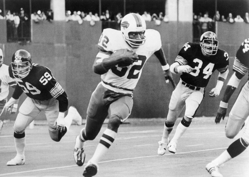 O.J. Simpson breaks away from Steeler tacklers Jack Russell (59) and Andy Russell (34) to run 87-yards for a touchdown in the third quarter of the game.