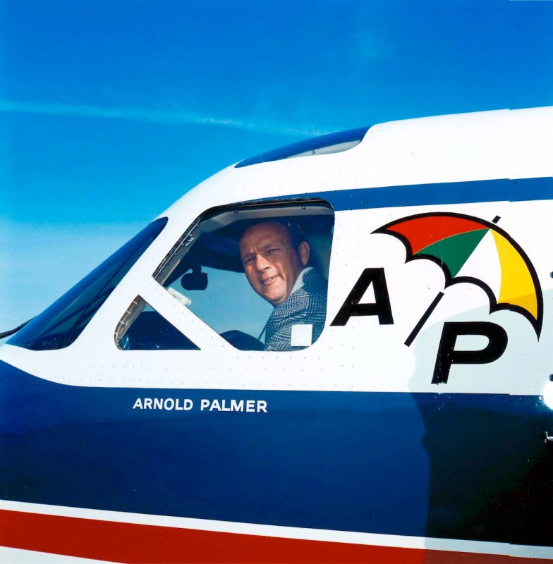 Arnold Palmer peers out the window of his personal airplane around 1965 in Latrobe, Pennsylvania. (Photo by Transcendental Graphics/Getty Images)