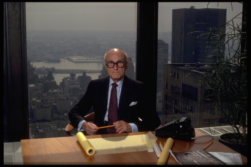 Philip Johnson, known for his architectural achievements, at his desk in his New York City office. (Photo by Corbis/VCG via Getty Images)