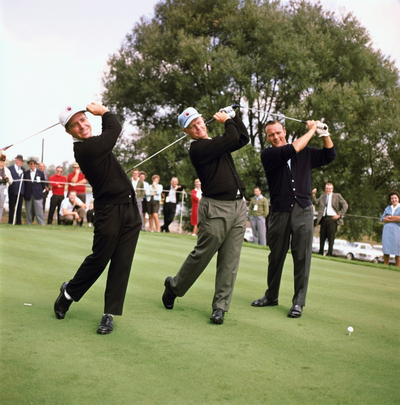 (Original Caption) Arkon, O.: Firestone Country Club, big three golfers in the world series of golf. Arnold Palmer, hatless, Jack Nicklaus (center) and Gary Player swing their clubs before a practice round.