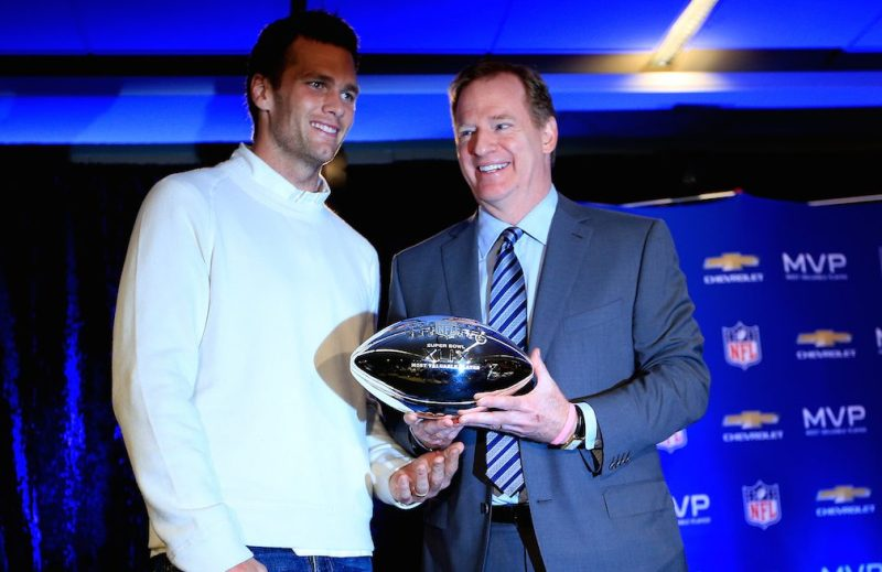 PHOENIX, AZ - FEBRUARY 02: (L-R) Tom Brady of the New England Patriots with NFL Commissioner Roger Goodell and the Super Bowl XLIX MVP trophy during a press conference folowing the Patriots Super Bowl win over the Seattle Seahawks on February 2, 2015 in Phoenix, Arizona. (Photo by Jamie Squire/Getty Images)