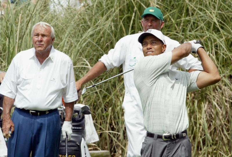 AUGUSTA, UNITED STATES: Golf legend Arnold Palmer(L) watches the tee shot of Tiger Woods 07 April 2004 during the Par 3 contest at Augusta National Golf Club in Augusta, Georgia, site of the Masters Golf Tournament. This is Palmer's 50th and final Master's appearance. AFP PHOTO Timothy A. CLARY (Photo credit should read TIMOTHY A. CLARY/AFP/Getty Images)