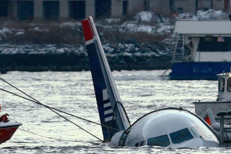 Rescue crews secure a US Airways flight 1549 floating in the water after it crashed into the Hudson River January 15, 2009 in New York City. The Airbus 320 craft crashed shortly after take-off from LaGuardia Airport heading to Charlotte, North Carolina. (Photo by Chris McGrath/Getty Images)