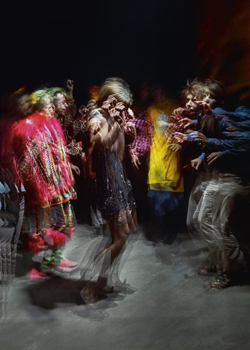 """Hollywood Acid Test, February 25, 1966. The psychedelic movement was the invention of the acid test events, where live music, movies, """"audioptics,"""" and the """"stroboscopic ballet machine"""" were standard features. The costumed revelers dancing into the small hours of the night endures as one of Schiller's most iconic images from his coverage of the LSD scene and was featured on the cover of the Capitol Records LP of the same name and year. (Lawrence Schiller/Polaris Communications Inc.)"""
