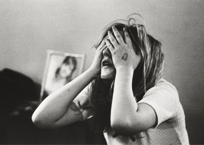 """A first-timer in the throes of a bad trip. """"I experienced the desire to die, but not actual death,"""" she later said, """"very strongly the desire to rip my skin off and pull my hair out and pull my face off."""" As the first national photojournalist to capture the American acid scene from the inside, Lawrence Schiller began with a single contact in Berkeley, California, and built a large network of young, receptive subjects who allowed him to document their private experiences with LSD. Hollywood, 1966. (Lawrence Schiller/Polaris Communications Inc.)"""