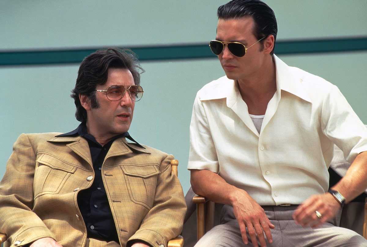 Johnny Depp as Joe Pistone, aka Donnie Brasco, with his