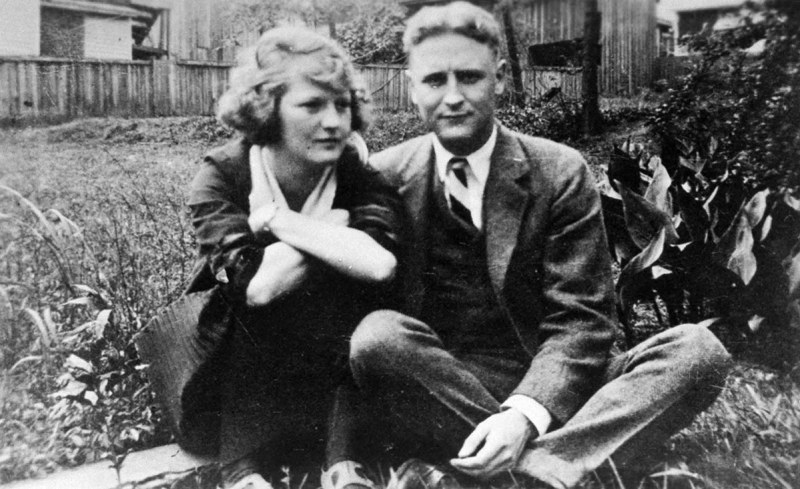 Family album snapshot of American novelist Francis Scott Key Fitzgerald (1896-1940) and wife Zelda sitting outside on lawn at her mother's home. (Photo by Time Life Pictures/Mansell/The LIFE Picture Collection/Getty Images)