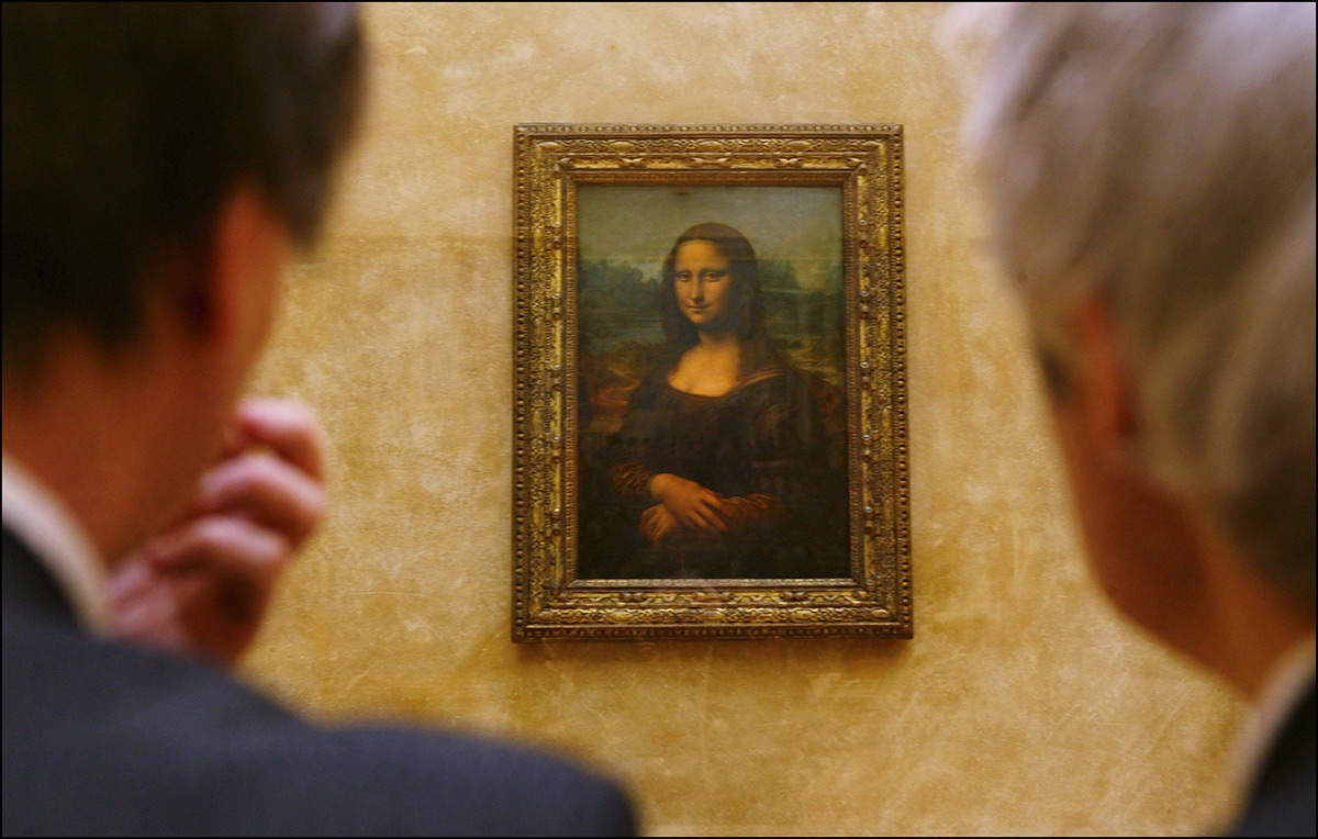 FRANCE - APRIL 06:  Leonardo da Vinci's masterpiece, Mona Lisa in her new setting in the refurbished Salle des Etats where the public was able to rediscover her in Paris, France on April 06th, 2005.  (Photo by Raphael GAILLARDE/Gamma-Rapho via Getty Images)
