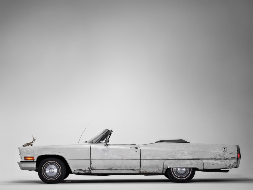 """James Gandolfini's 1970s Cadillac automobile. Purchased from a crew member of The Sopranos in 2004, Gandolfini often drove through the streets of Manhattan or the Jersey Shore, smoking a cigar with the top down. After his death, when his family was asked to choose his favorite possession for a magazine article, they picked """"the Cadillac."""" (Henry Leutwyler)"""