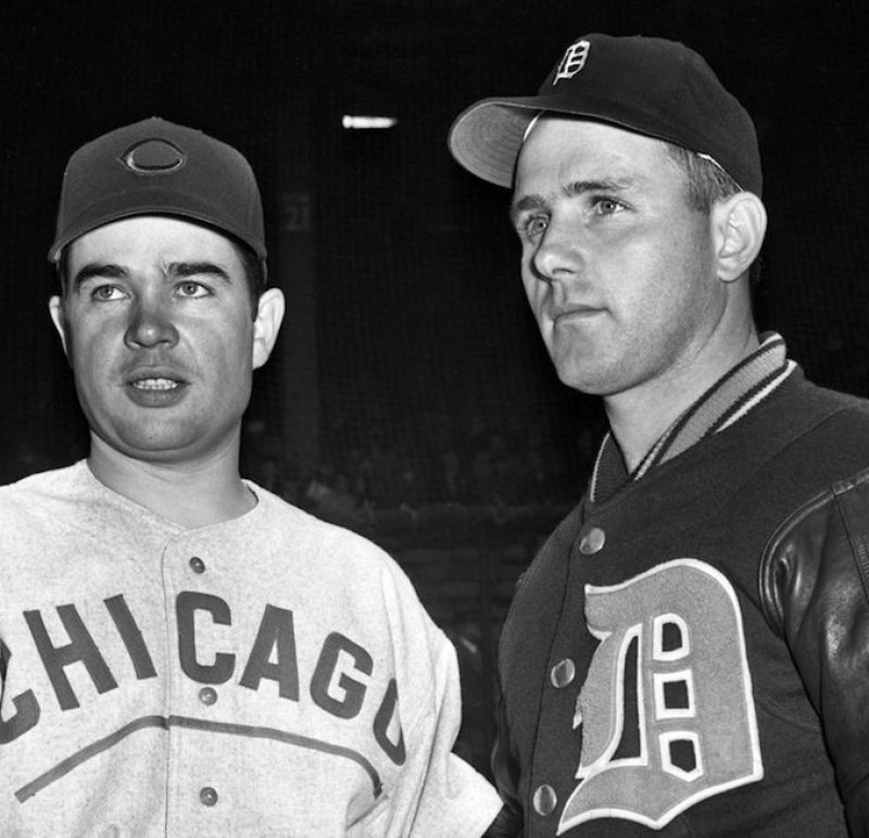 Hank Wyse (left), of the Cubs, and Virgil Trucks, of Detroit, shake hands before the start of the second World Series game, in which they took the mounds for their respective teams. Hank was yanked for a pinch-hitter in the seventh, but Virgil stayed all the way to ring up a 4-1 victory for Detroit.