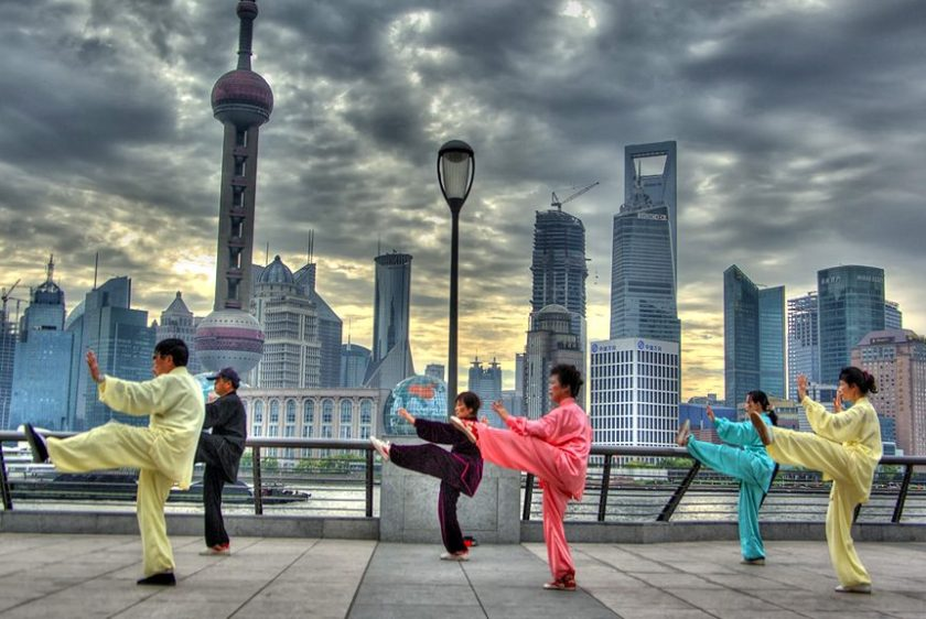 Group practicing Tai Chi in front of Shanhai skyline (leniners/Flickr)