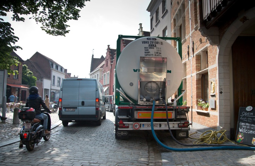 A truck pumping beer is parked outside at the Halve Maan Brewery in Bruges, Belgium on Thursday, May 26, 2016. The use of trucks will soon be a thing of the past as the brewery has recently created a beer pipeline which will ship beer straight from the brewery to the bottling plant, two kilometers away, through underground pipes running between the two sources. (AP Photo/Virginia Mayo)