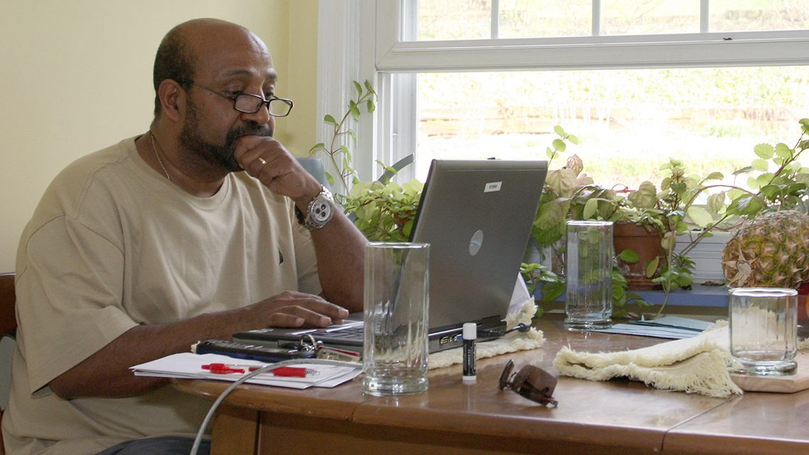 Dr. Berhanu Nega works on his computer in the kitchen of his house in Lewisburg, Pa., Saturday, April 25, 2009. The Ethiopian government has arrested 35 people suspected of a coup attempt allegedly backed by Nega, an Ethiopian economist now teaching at a Pennsylvania university, a government spokesman said Saturday. (AP Photo/John Zeedick)