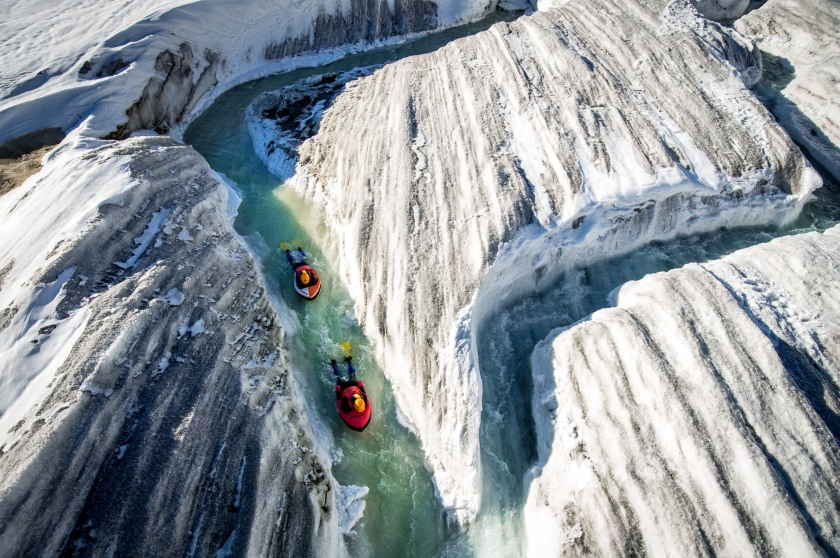 Seen carving their way through the icy rivers of the Aletsch Glacier in Switzerland, Swiss mountain guide, Claude-Alain Gailland and canyon activity specialist, Gilles Janin, are part of only a handful people in the world qualified enough to perform the treacherous run. Located on a UNESCO world heritage site, mountaineering photographer, David Carlier, 42, spent five hours trudging through the icy terrain to reach the summit of the colossal ice mass. (David Carlier/Caters News)