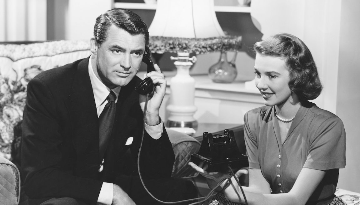 Dr. Madison Brown (Cary Grant) talks on the phone as Anabel Sims (Betsy Drake) sits beside him in a scene from the 1948 comedy Every Girl Should Be Married. (John Springer Collection/CORBIS/Corbis via Getty Images)