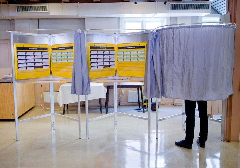 A man stands inside a polling booth in Norway. (Daniel Sannum Lauten/AFP/Getty Images)