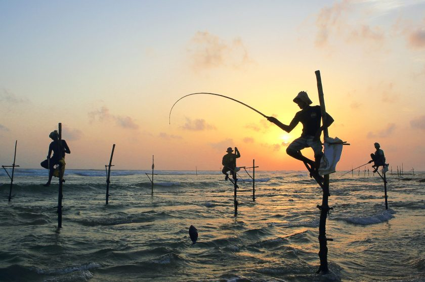 Sri Lankan stilt fishermen at sunset on the south coast. (Paul Kennedy/Lonely Planet Images/ Getty Images)