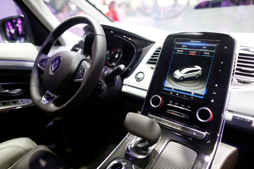 The driving control system and multi-sense computer panel sit on display inside the new Renault Espace automobile, produced by Renault SA, following its unveiling on the preview day at the Paris Motor Show in Paris, France, on Thursday, Oct. 2, 2014. (Simon Dawson/Bloomberg via Getty Images)