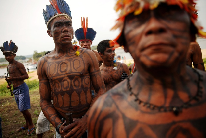 "Members of the Munduruku indigenous tribe gather along the Tapajos River during a ""Caravan of Resistance'"" protest by indigenous groups and supporters who oppose plans to construct a hydroelectric dam on the Tapajos River in the Amazon rainforest on November 27, 2014 in Sao Luiz do Tapajos, Para State, Brazil. (Mario Tama/Getty Images)"