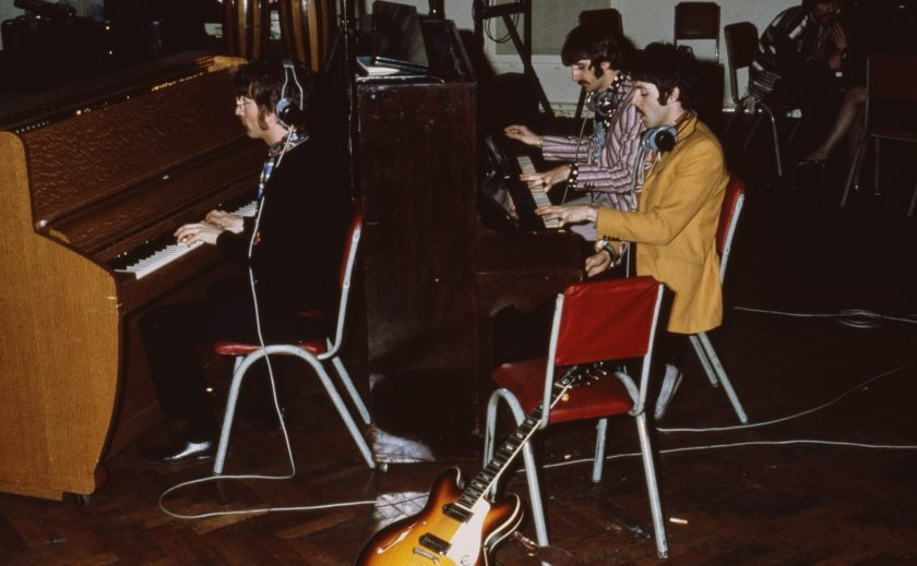 The Beatles play pianos at Abbey Road Studios, London, circa 1967. (Mark and Colleen Hayward/Getty Images)