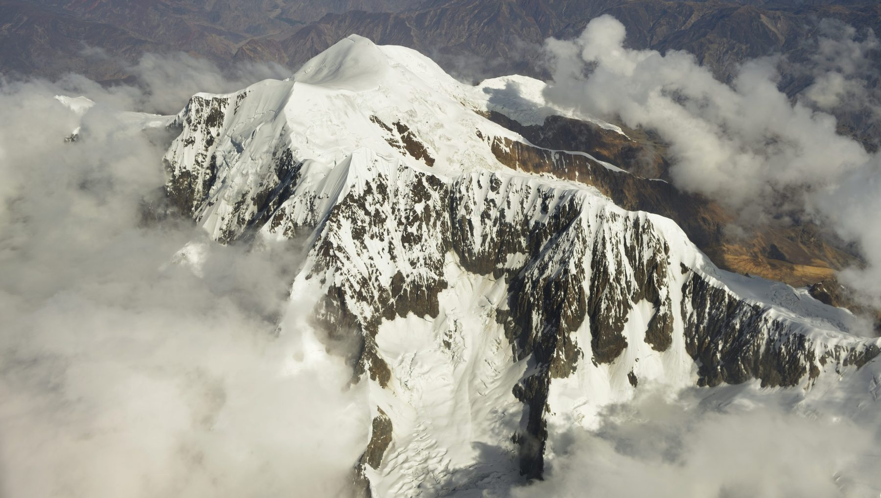 Peak of the Illimani Glacier as seen from an aircraft, near La Paz, Bolivia