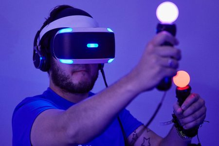 A gamer tests out Playstation VR (Virtual Reality) on the Sony PS4 on in Birmingham, England. The UK Gaming Industry contributed more than 1 billion to the UK's GDP in 2013 and estimates now put it's worth at  nearer 1.72 billion.  (M Bowles/Getty Images)