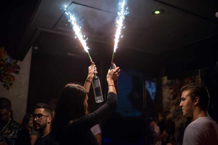 Wildflower nightclub makes a spectacle when someone orders bottle service, a server will bring out the bottle with a sparkle stuck in the neck and will proceed to dance at the table. The average bottle service costs $250 at nightclubs in the area. (Brian B. Bettencourt/Toronto Star via Getty Images)