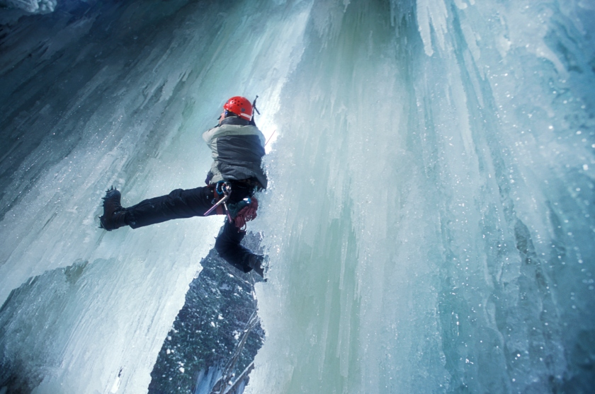 A man ice climbs a frozen waterfall in western Maryland. 2001. (Tim Tadder/Corbis via Getty Images)