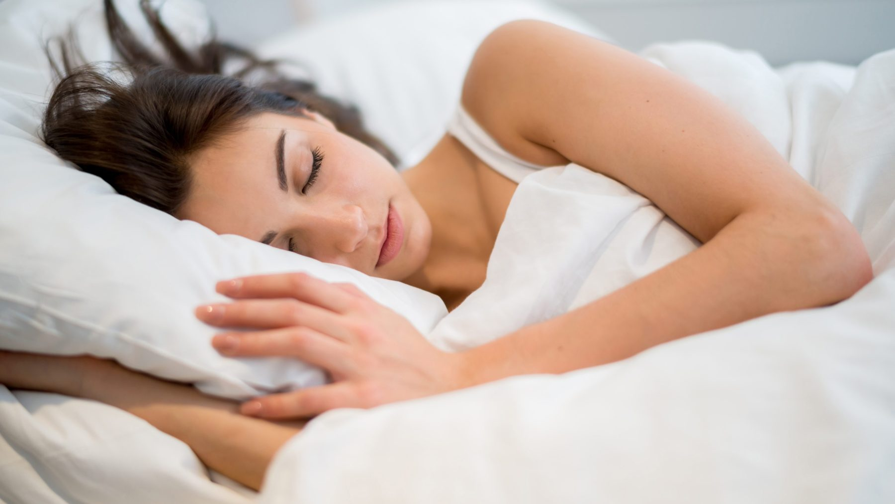 Woman sleeping at home in her bed (Getty Images)