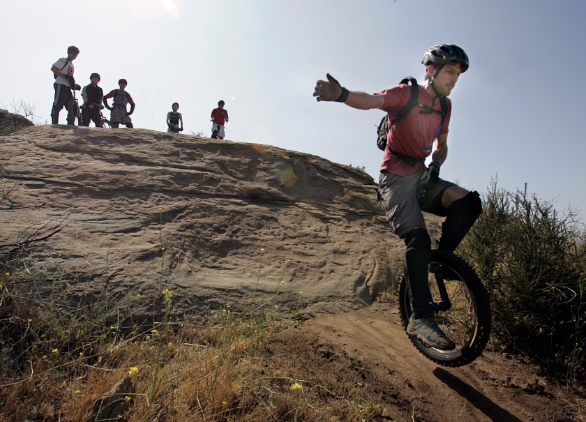 Mountain unicycling is growing and one of the preferred locations is Rocky Peak Nature Trails in Simi Valley. Eyal Aharoni, 28 of Santa Barbara, sets off down the trail at Rocky Peak. (Carlos Chavez/Los Angeles Times via Getty Images)