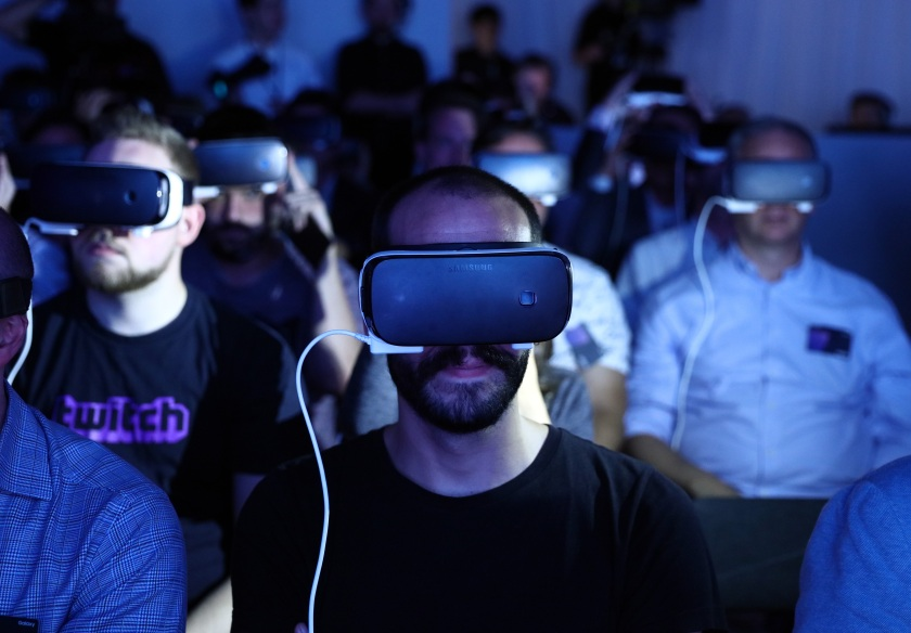 Visitors wear Gear VR 4D Experience headsets with the Galaxy Note 7 smartphone during a Samsung Electronics Co. 'Unpacked' launch event in London, U.K., on Tuesday, Aug. 2, 2016. The South Korean company announced the latest iteration of its large-screen smartphone with the 5.7-inch Note 7 that can be unlocked with an iris-scanning camera. (Chris Ratcliffe/Bloomberg via Getty Images)