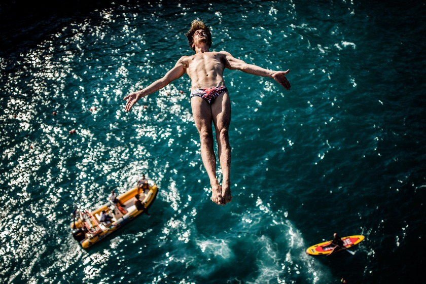 POLIGNANO A MARE, ITALY - AUGUST 26: (EDITORIAL USE ONLY) In this handout image provided by Red Bull, Gary Hunt of the UK dives from the 27 metre platform during the first training session for the fifth stop of the Red Bull Cliff Diving World Series, Polignano a Mare, Italy. (Photo by Dean Treml/Red Bull via Getty Images)