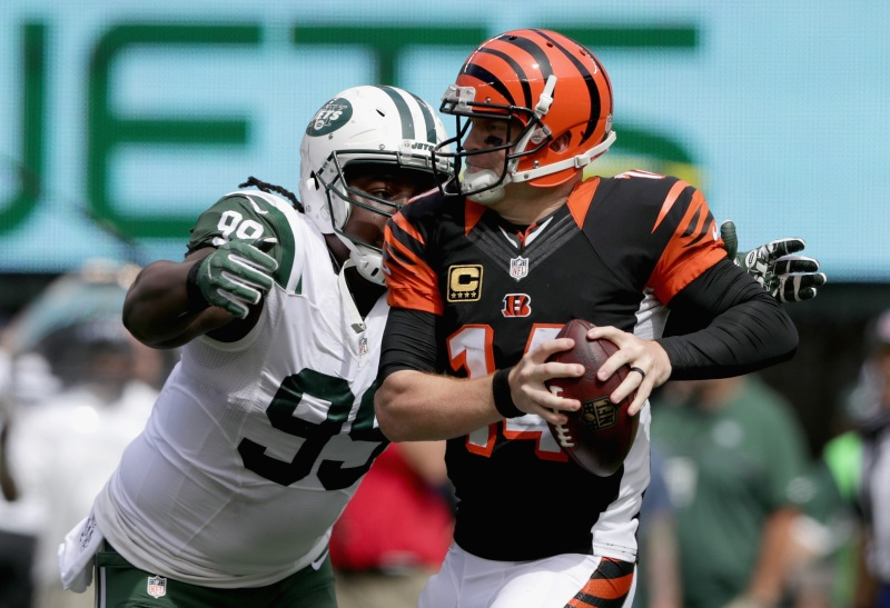 Steve McLendon #99 of the New York Jets sacks Andy Dalton #14 of the Cincinnati Bengals during their game at MetLife Stadium on September 11, 2016 in East Rutherford, New Jersey. (Streeter Lecka/Getty Images)