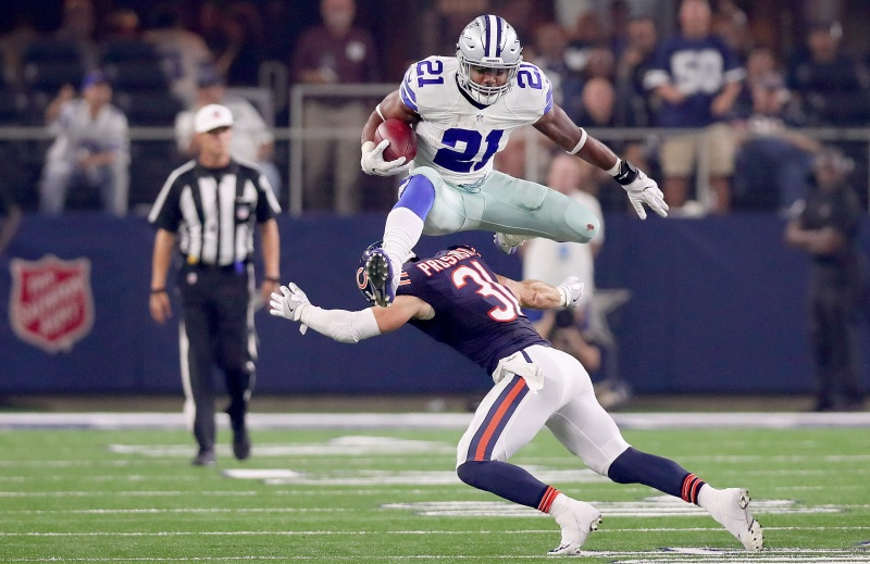 Ezekiel Elliott #21 of the Dallas Cowboys hurdles Chris Prosinski #31 of the Chicago Bears while carrying the ball in the fourth quarter at AT&T Stadium on September 25, 2016 in Arlington, Texas. (Tom Pennington/Getty Images)