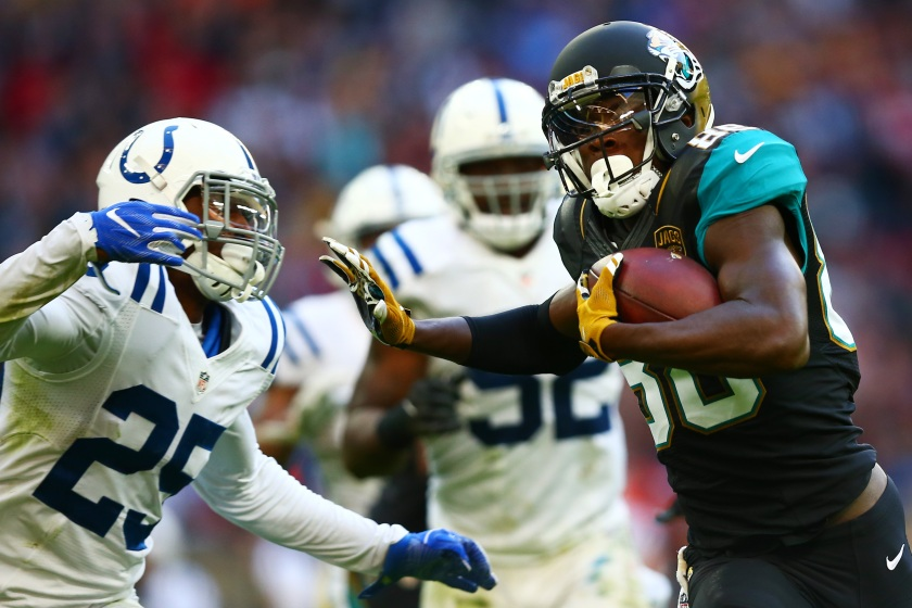 Allen Hurns #88 of the Jacksonville Jaguars hands off Patrick Robinson #25 of the Indianapolis Colts to score a touchdown during the NFL game between Indianapolis Colts and Jacksonville Jaguars at Wembley Stadium on October 2, 2016 in London, England. (Photo by Dan Istitene/Getty Images)