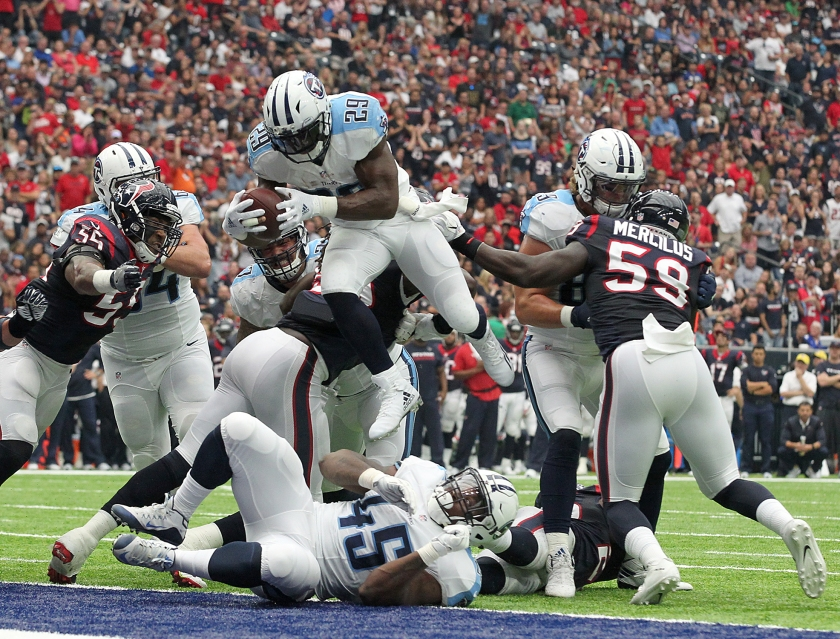 DeMarco Murray #29 of the Tennessee Titans leaps over the Houston Texans defensive line for a touchdown in the second quarter during the NFL game between the Tennessee Titans and the Houston Texans at NRG Stadium on October 2, 2016 in Houston, Texas. (Thomas B. Shea/Getty Images)