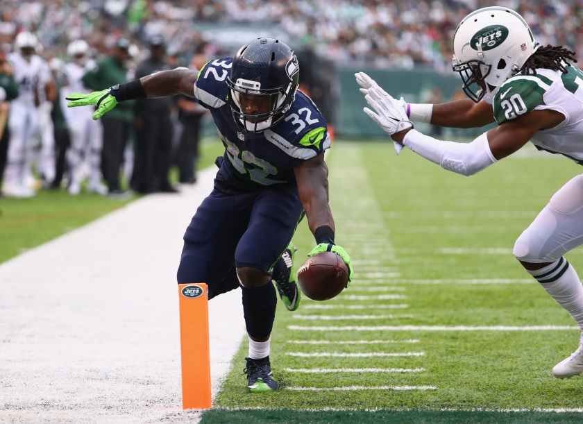 Christine Michael #32 of the Seattle Seahawks scores a touchdown against Marcus Williams #20 of the New York Jets in the fourth quarter at MetLife Stadium on October 2, 2016 in East Rutherford, New Jersey. (Photo by Al Bello/Getty Images)