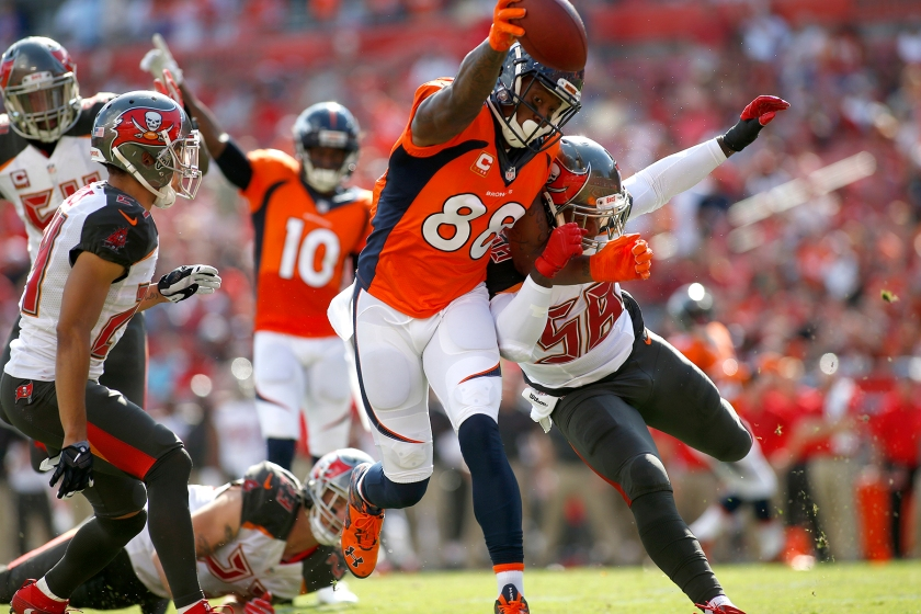Wide receiver Demaryius Thomas #88 of the Denver Broncos fends off middle linebacker Kwon Alexander #58 of the Tampa Bay Buccaneers as crosses the goal line for a touchdown during the first quarter of an NFL game on October 2, 2016 at Raymond James Stadium in Tampa, Florida. (Brian Blanco/Getty Images)