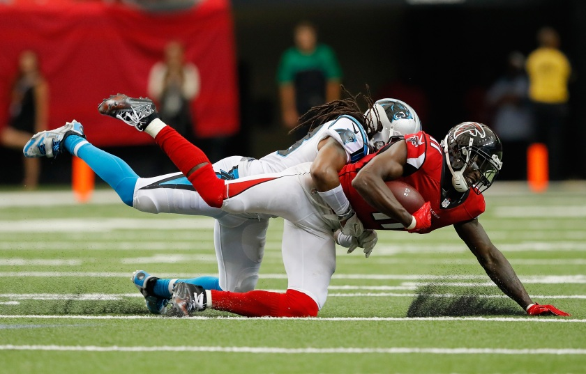Julio Jones #11 of the Atlanta Falcons dives for more yardage as he is tackled by Tre Boston #33 of the Carolina Panthers at Georgia Dome on October 2, 2016 in Atlanta, Georgia. (Kevin C. Cox/Getty Images)