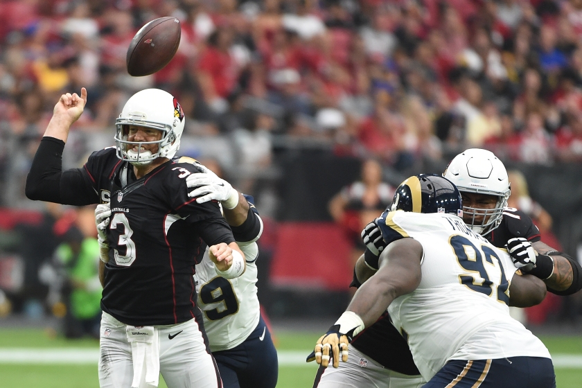 Quarterback Carson Palmer #3 of the Arizona Cardinals is hit by defensive tackle Aaron Donald #99 of the Los Angeles Rams during the second half of the NFL game at University of Phoenix Stadium on October 2, 2016 in Glendale, Arizona. (Norm Hall/Getty Images)