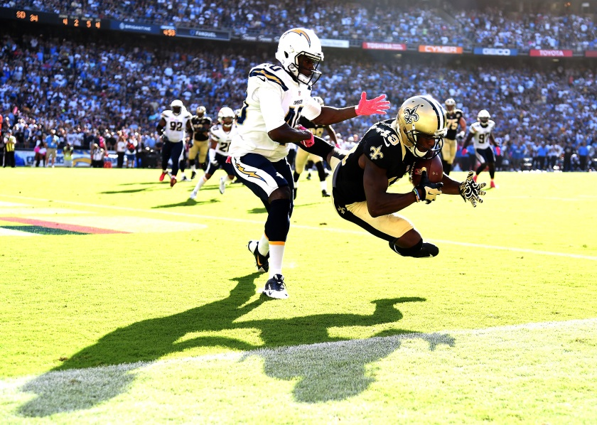 Michael Thomas #13 of the New Orleans Saints makes a catch for a touchdown in front of Pierre Desir #40 of the San Diego Chargers to trail 28-34 during the fourth quarter at Qualcomm Stadium on October 2, 2016 in San Diego, California. The Saints came back to win 35-34. (Photo by Harry How/Getty Images)