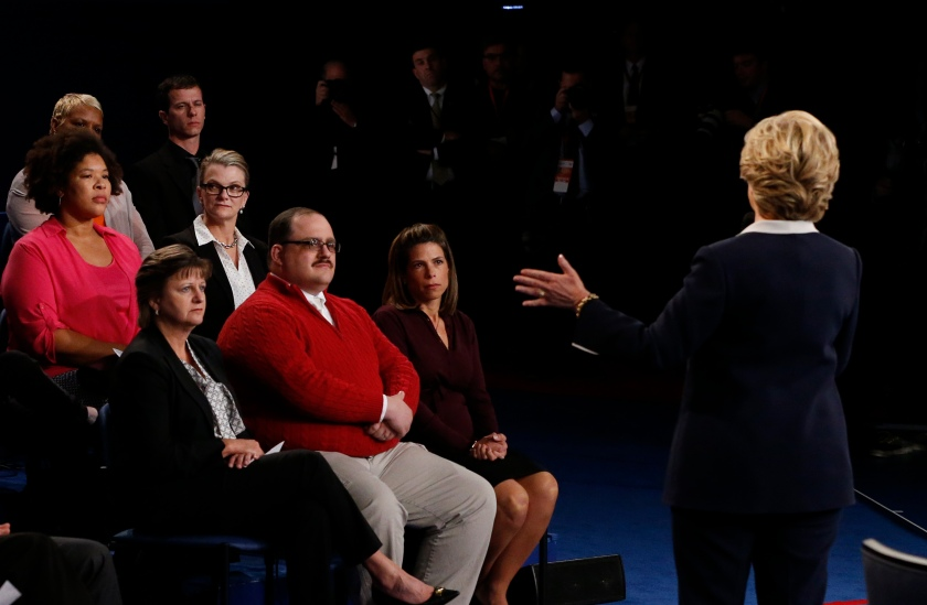 US Democratic presidential candidate Hillary Clinton speaks during the second presidential debate with Ken Bone (center) at Washington University in St. Louis, Missouri, on October 9, 2016. (Jim Bourg/AFP/Getty Images)